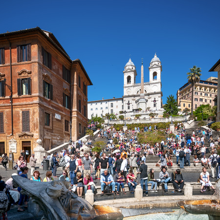 Rome, Italy - May 15, 2012: Tourists visiting the Spanish Steps.  Spanish Steps  are a set of steps in Rome. It is one of Rome