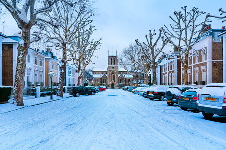 st jamess: Snow covered, cosy street in Holland Park, London. (St James?s Church in the middle.)