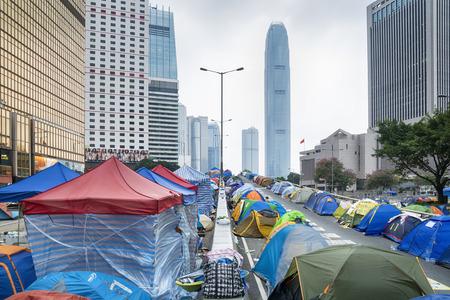 protestor: Hong Kong, Hong Kong SAR -November 11, 2014:  Umbrella Revolution, Hong Kong. Tents set up to block the road at the Admiralty on 11  November 2014. Hong Kong campaigners are fighting for the right to nominate and directly elect the head of the Hong Kong g