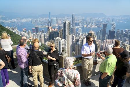 Hong Kong, Hong Kong SAR -November 15, 2014: Tourists at Victoria Peak in Hong Kong. Victoria Peak is one of the most popular spot among tourist visiting Hong Kong.