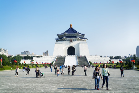 Taipei, Taiwan - Dec 29, 2014:Tourists at the Chiang Kai-Shek Memorial Hall in Taipei. Chiang Kai-shek Memorial Hall is a popular travel destination among tourists visiting Taiwan.