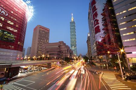 trafic: Taipei, Taiwan - Dec 30, 2014:  Taipei, Xinyi District at night (including Taipei 101). The Xinyi District is the seat of the Taipei mayor