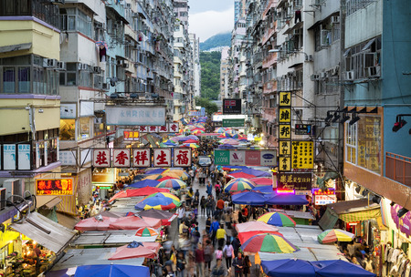 Hong Kong, Hong Kong SAR -November 08, 2014: Busy street market at Fa Yuen Street at Mong Kok area of Kowloon, Hong Kong. Editorial