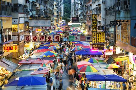Hong Kong, Hong Kong SAR -November 08, 2014: Busy street market at Fa Yuen Street at Mong Kok area of Kowloon, Hong Kong. Редакционное