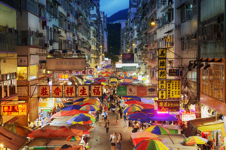 old sign: Hong Kong, Hong Kong SAR -November 08, 2014: Busy street market at Fa Yuen Street at Mong Kok area of Kowloon, Hong Kong. Editorial