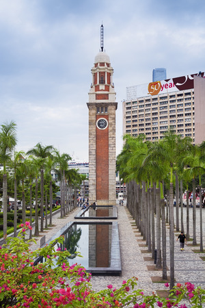 remnant: Hong Kong, Hong Kong SAR -November 09, 2014:`The Clock Tower` in Tsim Sha Tsui.  It is the only remnant of the original site of the former Kowloon Station on the Kowloon-Canton Railway. Editorial