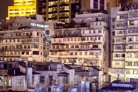night city: Apartment buildings at night in Hong Kong. Stock Photo