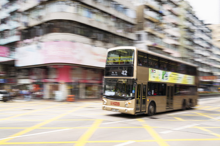 doubledecker: Hong Kong, Hong Kong SAR -November 13, 2014: Rush hour in Hong Kong, double-decker in blurred motion.