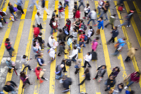 walking street: Hong Kong, Hong Kong SAR -November 13, 2014: Crowded pedestrian crossing during rush hour in Hong Kong.