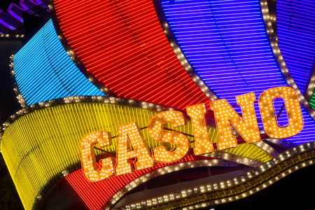 Casino neon sign at night. Stock Photo
