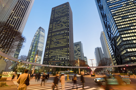 japanese people: Commuters rushing home after office hours  in Shinjuku, Tokyo - Japan.
