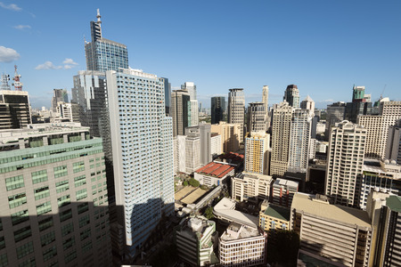 entire: Makati City Skyline. Makati City is one of the most developed business district of Metro Manila and the entire Philippines. Stock Photo