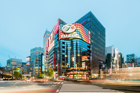 tokyo prefecture: Tokyo, Japan - January 21, 2016: Evening rush hour near Fujiyma Building in the Ginza District in the Ch?? area of Tokyo, one of the most luxurious shopping districts in the world. Editorial