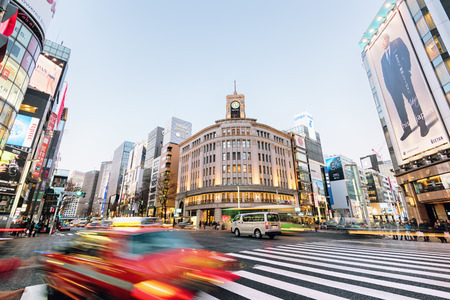 stereotypically: Tokyo, Japan - Dec 10, 2015:  Ginza shopping district at rush hour in Tokyo. The iconic Ginza Wako building is at the background.