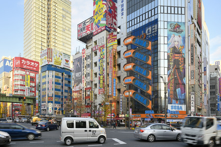 city traffic: Tokyo, Japan -January 8, 2016: Cityscape of Akihabara district in Tokyo. Akibahara is otaku cultural center and a shopping district for video games, anime, manga, and computer goods.