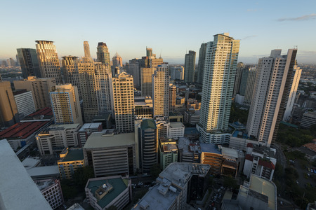 philippines: Manila, Philippines -February 23, 2016: Makati City Skyline at sunset . Makati City is one of the most developed business district of Metro Manila and the entire Philippines. Editorial