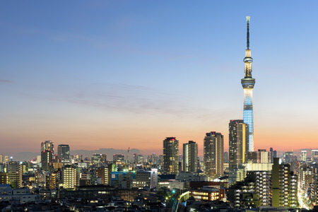 tokyo prefecture: Tokyo; Japan -January 9; 2016: Tokyo Skyline at dusk, view of Asakusa district and the Sumida River. Skytree visible in the distance.