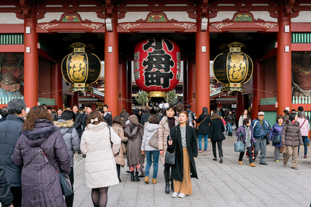 large crowd: Tokyo; Japan -January  07: Large crowd including a group mother and daughter taking a groufie  at the Hozomon Gate at Senso-ji Temple Asakusa, Tokyo.