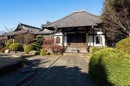 survives: Tokyo, Japan - January 09, 2016:  Enmei-ji Temple in Yanaka, Tokyo - Japan.Yanaka  is one of the few districts in Tokyo where the shitamachi atmosphere, an old town ambience reminiscent of Tokyo from past decades, still survives.