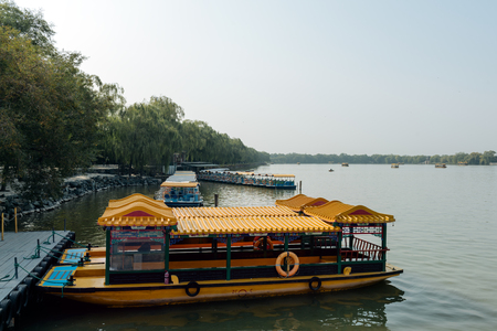 oriental ethnicity: Beijing, China - October 19, 2015:Traditional Chinese Boats at Summer Palace in Beijing. The Summer Palace, is a vast ensemble of lakes, gardens and palaces in Beijing, China.
