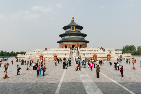regarded: Beijing, China - October 18, 2015: Visitors at the Temple of Heaven in Beijing, China. The Temple of Heaven is regarded as one of the Beijings Top 10 tourist attractions.