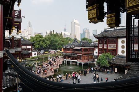 Shanghai, China - October 16, 2015: Traditional Chinese architecture in Yuyuan Garden. Yuyuan Gardens is an extensive Chinese garden located beside the City God Temple in the northeast of the Old City of Shanghai, China. Фото со стока