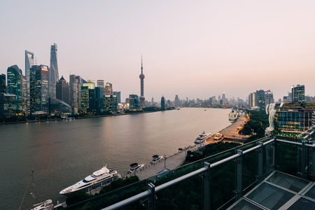 shanghai pudong skyline: Shanghai, China - October 16, 2015:  Elevated view of  Pudong skyline in Shanghai- China. Pudong is a district of Shanghai, located east of the Huangpu River across from the historic city center of Shanghai in Puxi.