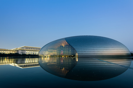 Beijing, China - Oct 19, 2015: National Centre for the Performing Arts, colloquially described as The Giant Egg, is an arts centre containing an opera house in Beijing, Peoples Republic of China. Stock Photo