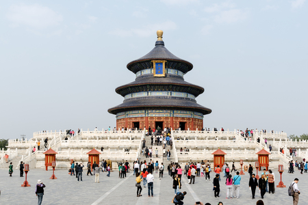 Beijing, China - October 18, 2015: Visitors at the Temple of Heaven in Beijing - China. The Temple of Heaven is  one of the Beijings Top 10 tourist attractions.