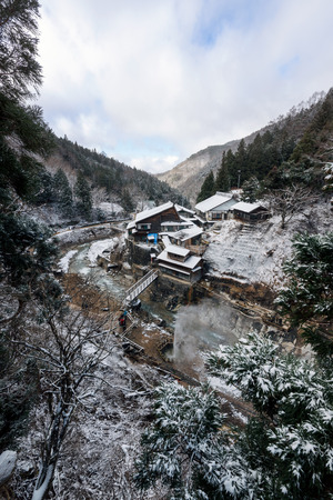 ryokan: Nagano, Japan - December 27, 2015: Korakukan Ryokan near Snow Monkey Park, Yamanouchi, Japan. A ryokan  is a type of traditional Japanese inn that originated in the Edo period (1603�1868), when such inns served travelers along Japans highways.
