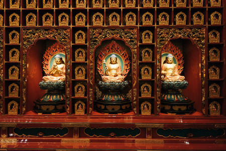 Singapore, Singapore - February 24, 2017: Interior of the  Buddha Tooth Relic Temple and Museum. The temple is a popular attraction within Chinatown. Simple vegetarian fare is served in the basement of the temple, though donations are accepted. Editorial