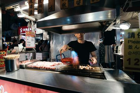 Taipei, Taiwan - April 4, 2017: Raohe Street Night Market, Taipei, Taiwan.It is one of the oldest night markets in Songshan District, Taipei, Taiwan.