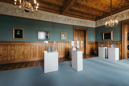 Schwerin, Germany - Sept 10, 2017: interior and exhibition of the Schwerin Castle Museum. The museum shows the splendor of ducal times with beautiful rooms, weapons, fine china and silver.