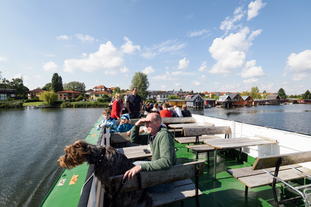 Schwerin; Germany - Sept 10; 2017: Tourist on a boat are enjoying the view on the Heidensee (lake); in Schwerin; Germany. Editorial