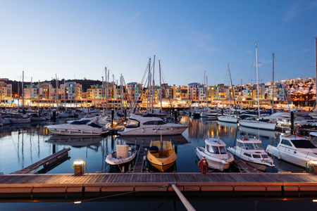 Albufeira, Portugal - April 17: Night view of Luxury yachts and motorboats at the Albufeira Marina at Night. Albufeira is a coastal city in the southern Algarve region of Portugal. It's a former fishing village that has become a major holiday destinatio