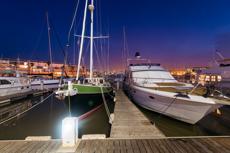 Lagos, Portugal - April 22: Night view of Luxury yachts and motorboats at the Lagos Marina at Night. Lagos is a coastal city in the southern Algarve region of Portugal. Editorial