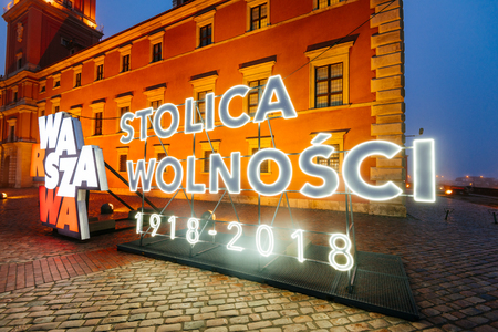 Warsaw, Poland - October 29, 2018:  Neon Sing installation in the Old of Warsaw.  Poland celebrating one hundred year anniversary of independence on 11th of November 2018. Neon sign  Warsaw - the capital of freedom (Warsaw, Poland).