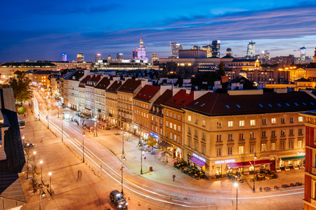 Warsaw, Poland - October 30, 2018: The Krakowskie Przedmiescie street in the Old Town of Warsaw. it is one of the central historic streets of Warsaw seen from above at night.  Редакционное