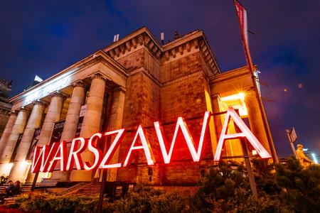 Warsaw, Poland - November 2, 2018:  Warsawa Neon Sing at night at the Palace of Culture and Science in Warsaw, Poland, Редакционное