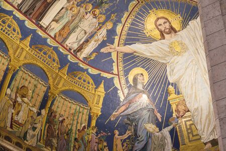 Paris, France - Sept 04, 2019: Jesus Christ figure on the wall of Basilica of Sacre Coeur (Sacred Heart), Paris, France