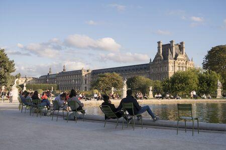 Paris, France - Sept 04, 2019: People relaxing in Tuileries Garden (Jardin des Tuileries), Paris, France