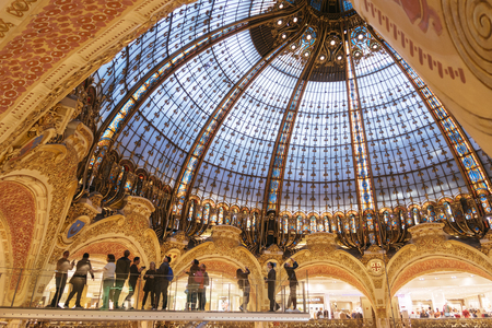 Paris, France - Sept 05, 2019: Tourists at the glasswalk in the Galeries Lafayette interior in Paris. The architect Georges Chedanne Editöryel