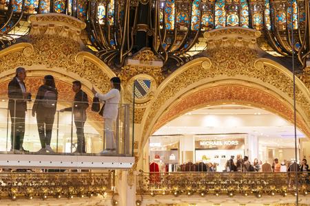 Paris, France - Sept 05, 2019: Tourists at the glasswalk in the Galeries Lafayette interior in Paris.