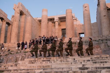 Athens, Greece - Dec 20, 2019: Greek soldiers march in formation while on patrol at the Acropolis of Athens.  Soldiers go to Acropolis to lower a Greek flag every evening. Stock Photo - 141810590
