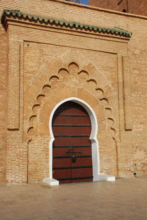 White surround to a massive wooden door on this entrance to the Koutoubia Mosque, Marrakesh  photo