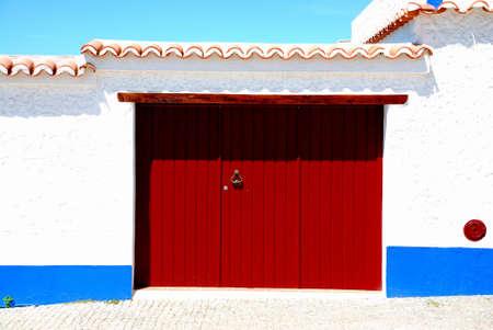 Rural door in a little village, Porto Covo, Portugal  photo