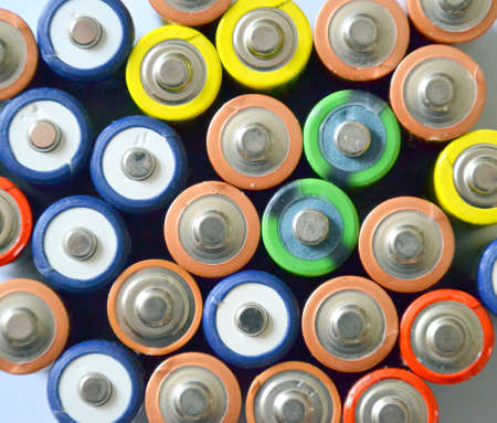 Concept background of colorful batteries  photo