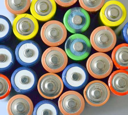 カラフルな電池の概念の背景 写真素材