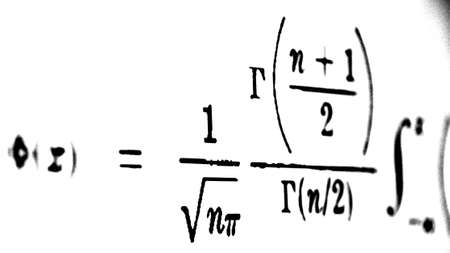 Large number of mathematical formulas on a white background Stock Photo