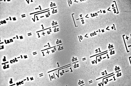 Large number of mathematical formulas on a white background HDR Stock Photo
